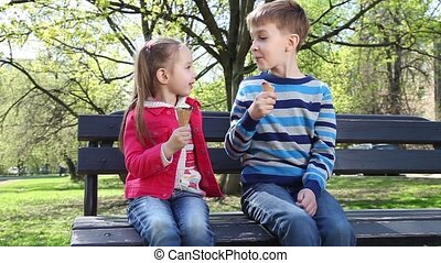 Cheerful kids enjoying ice creams - Cheerful brother with...