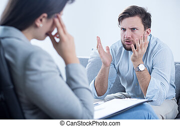 Complaining about problems - Angry young man complaining his...