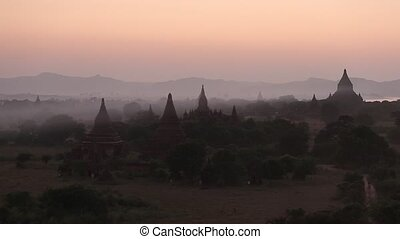 stupa - Myanmar Bagan historical site on magical sunset with...