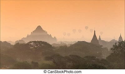 stupa - Scenic sunrise with balloon above old pagodas at...