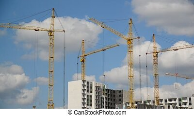 Construction cranes against sky - Construction cranes...