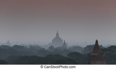 stupa - View of stupa field at morning with balloon in Bagan...