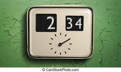 Clock on a green wall - A time-lapse image of a old-style...