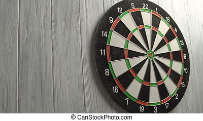 Playing Darts on White Wood Wall
