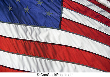 American flag flying proudly on a windy day