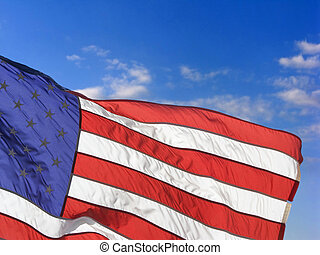 American flag flying proudly on a windy day - American Flag...