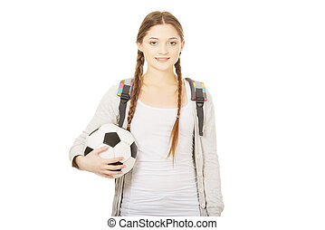 Young woman with foot ball - Teenager with schoolbag and...