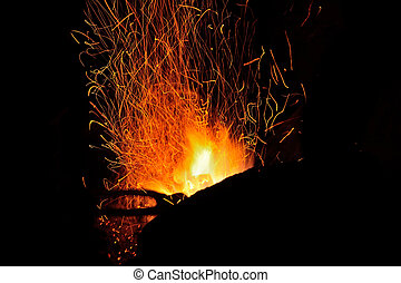 Sparks from the fire in the forge