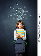 discovery - Educational concept Smiling schoolgirl standing...