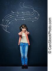 the creative impulse - Cute happy teen girl enjoys the music...