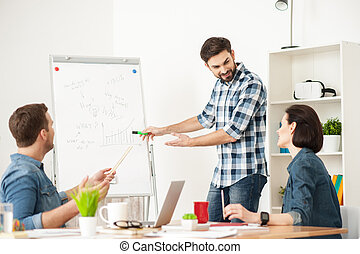 Skillful three workers have discussion in office - Handsome...