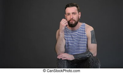 Young hipster takes thought - Young bearded man taking...