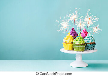 Cupcakes with sparklers - Cupcakes on a cake stand with...