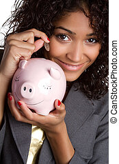 Woman Saving Money - Woman saving money with piggy bank