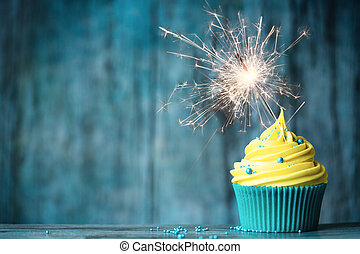 Celebration cupcake - Cupcake with yellow buttercream and a...