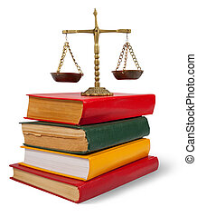 justice concept - Scales of justice atop legal books over...