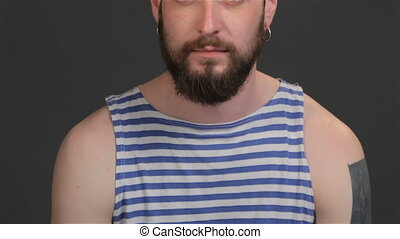 Bearded captain screams upwards - Close up of modern sailor...