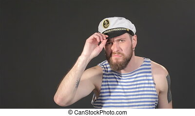 Bearded captain tidies himself - Handsome bearded captain...