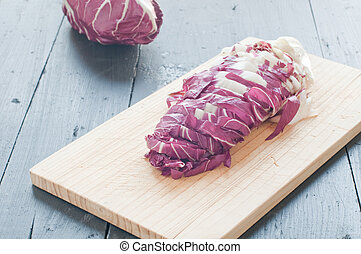 radicchio di Treviso red cut on a wooden cutting board,italy