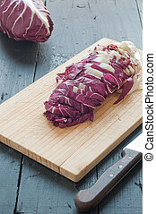 radicchio di Treviso red cut on a wooden cutting board