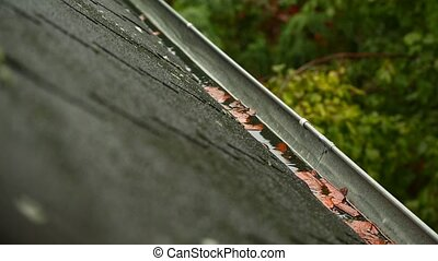 Raindrops falling in the eaves - Raindrops over the roof of...