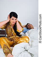 Snoring - Couple in bed with woman awake and nervous because...