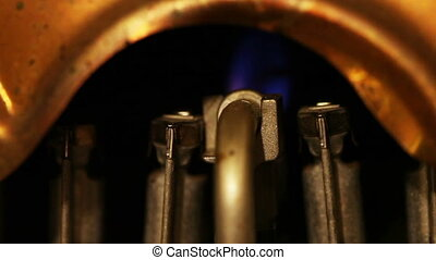 Geyser, water heater. The flame of a torch burns,