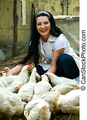 Laughing woman feeding chicken - Laughing woman feeding big...