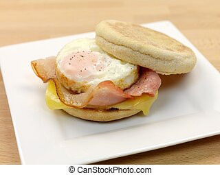 English Muffin Breakfast - A breakfast bacon egg and cheese...