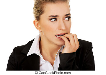 Stressed businesswoman biting her nails - Stressed...