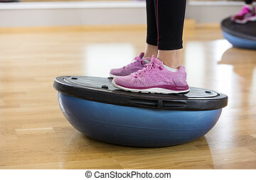 Low Section Of Woman Exercising On Bosu Ball - Low section...