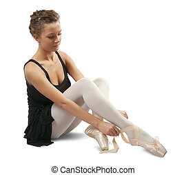Ballerina putting on pointes - young ballerina puts on...