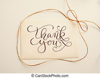 sheet of paper with bow and text thank you Greating card -...