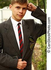 Boy in school uniform - a young Boy in school uniform