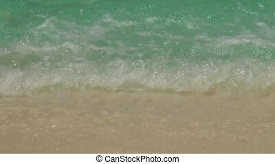 Sea waves surf on sandy beach. Maldives. Close up. - Sea...