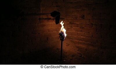 Torch light in the dark - Torch being ignited with another...