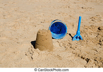 Bucket and spade - Sandcastle, bucket and spade on beach