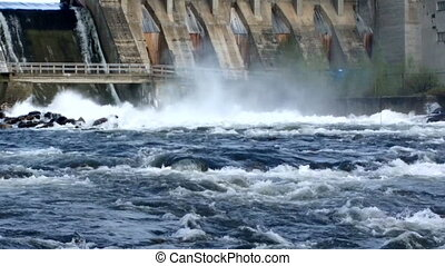 Powerful water discharge through gate of power plant - View...