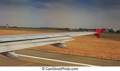 Airliner Moves along Runway after Landing by Field Houses