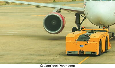 Airport Workers Talk under Engine by Fuselage on Airfield -...