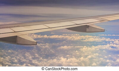 View White Clouds under Airliner Wing from Window - panorama...