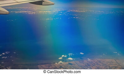 View Sea Land under Airliner Wing - panorama of sea and land...