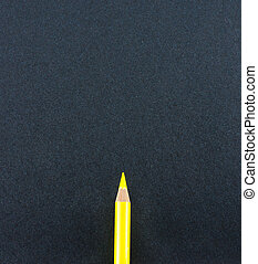 Yellow pencil lay on black craft paper background ,Mock up...