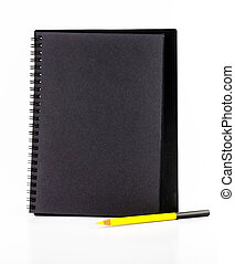 Black paper notebook with yellow pencil isolated on white...