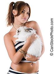 Playful young woman with rabbit - Playful young woman with...