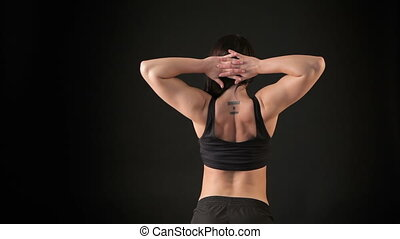Fitness woman showing her back muscles - Slim sports woman...