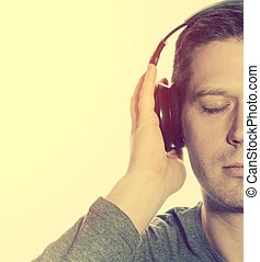 Man listening to the music in headphones.