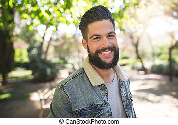 Toothy smile - A photo of young, handsome man posing to the...