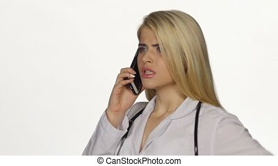 Doctor talking on the phone worried angry. White. Closeup -...