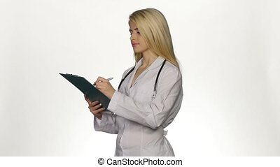 Health worker takes notes on clipboard. White - Health...